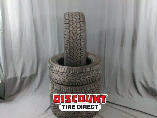 4 USED 22555-17 GENERAL ALTIMAX ARCTIC 12 STUDDED 55R R17 TIRES 36024