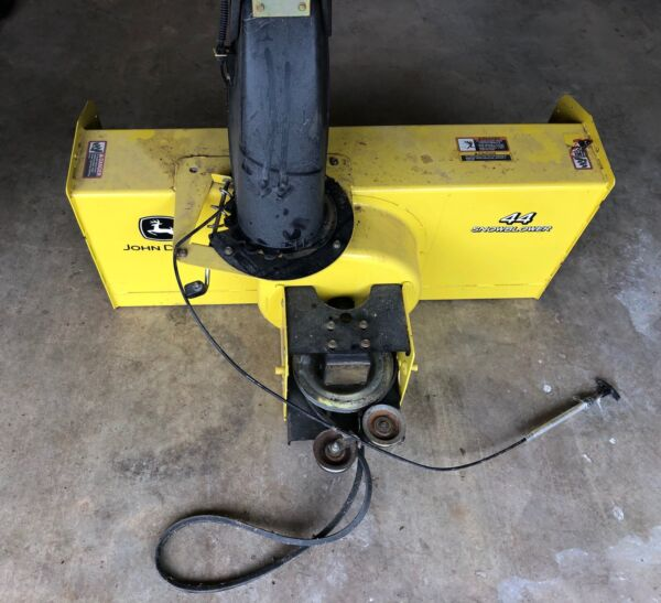 John Deere 44in Two Stage Snow Blower Attachment. Weights and chains included.