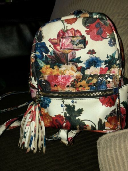Super cute small bebe floral backpack purse $22.00