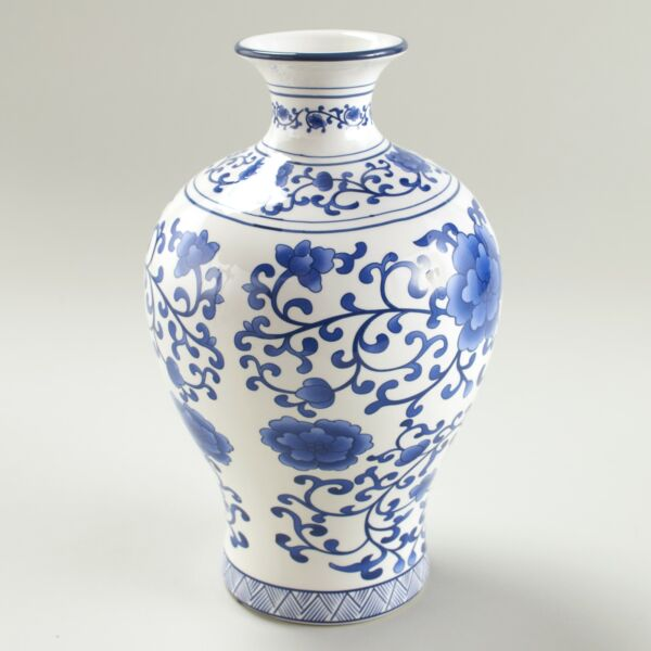 Blue and White Ceramic Decorative Vase with Floral Aesthetic $19.48