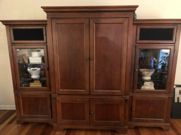 3 piece wood glass wall entertainment center. Excellent used condition. Brown $300.00