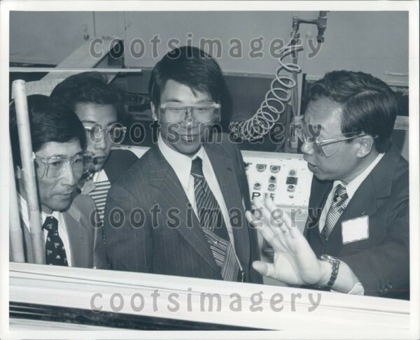 Oriental Men Wearing Safety Glasses Suits Industrial Setting Press Photo