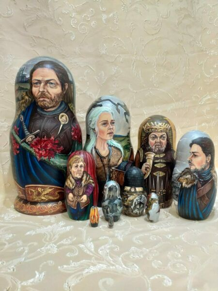 Russian nesting dollsmatryoshkahand painted by the artist Olga Tolstikhina.