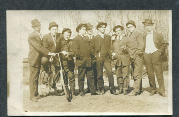 9 Men Wearing Hats One Bicycle Vintage Photo Postcard