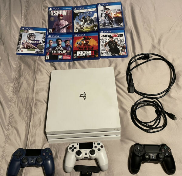 White PS4 Pro 1TB Bundle 7 Games 3 Controllers and Back Paddle $480.00