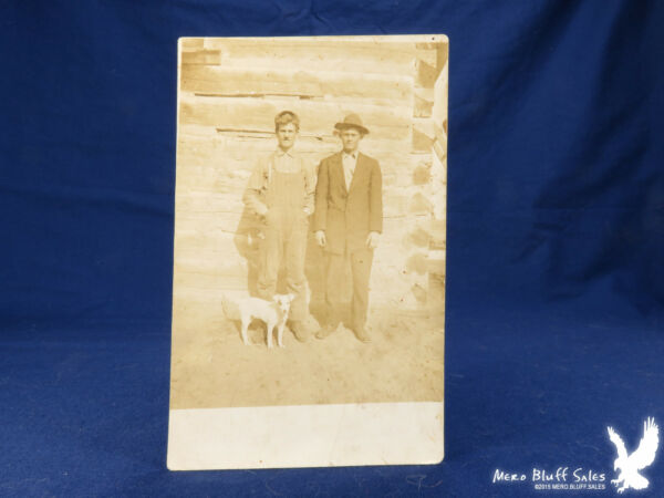 RPPC Fox Terrier Dog Two Men Log Building Dovetailed Corners Overalls $5.00
