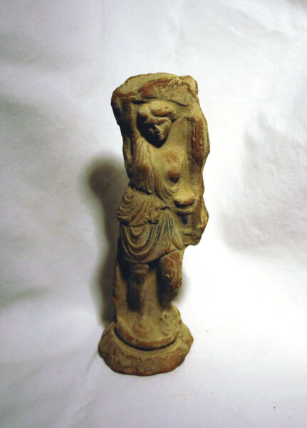 Antique statuette of a wounded Amazon