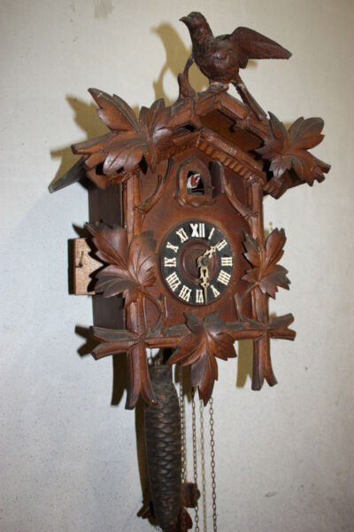 Antique black forest cuckoo clock carved with bird ca.1900