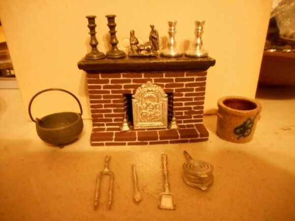 doll house fireplace with nativitycrock 4 candlestick holders and fireplace to