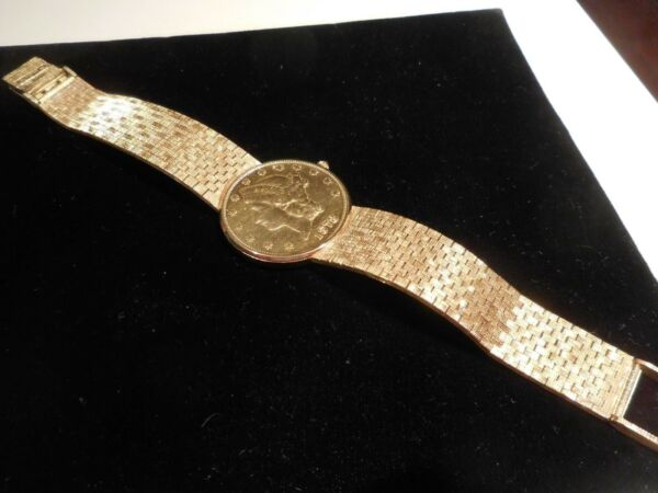 CORUM $20 GOLD COIN WATCH WITH 18K GOLD MESH BANK
