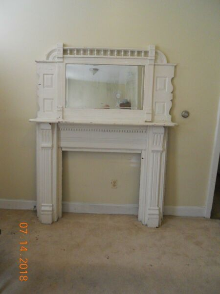 vintage wooden fireplace mantle with beveled mirror antique
