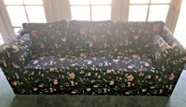 2 couches sofas black and floral used good condition