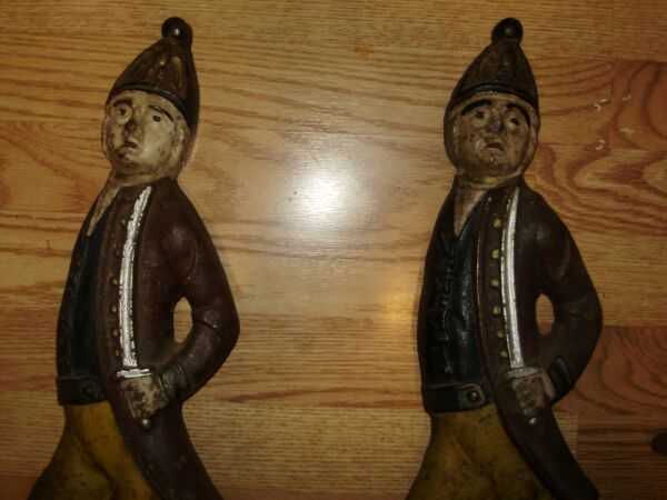 ANTIQUE CAST IRON ANDIRONS SOLDIERS(A SET) 19.25 INCHES TALL ORG. PAINT