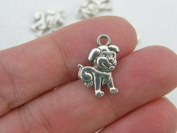 8 Dog charms ibetan silver A886 $3.50