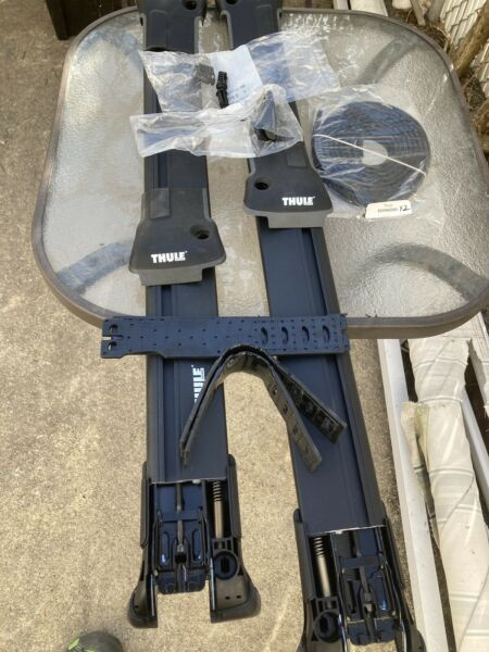 Thule Aeroblades Edge 7502B amp; 7501B with straps.locks are optional $300.00