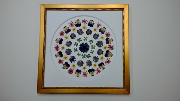Pressed flower art with 4 leaf clovers and white circle mat with gold frame