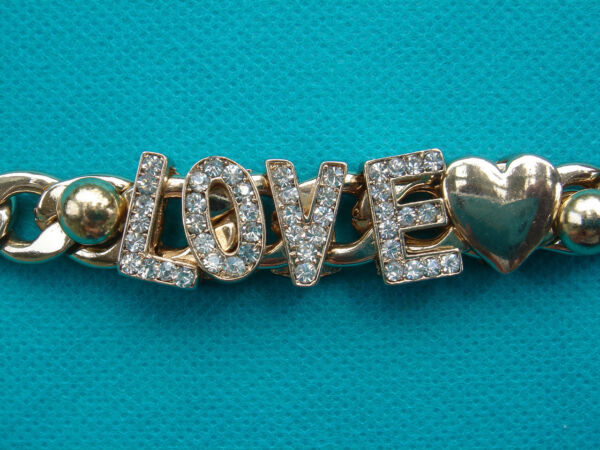Gold tone Crystal Rhinestone Love amp; Golden Heart Slide Charms Toggle Bracelet  $9.99