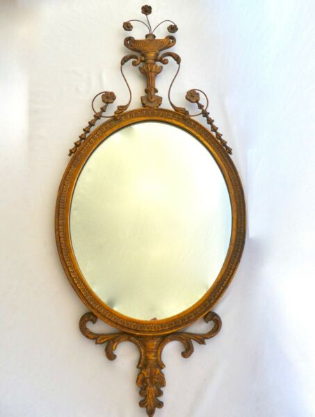 Antique Federal Style Carved Giltwood Oval Mirror. Lyrical Floral Patterns