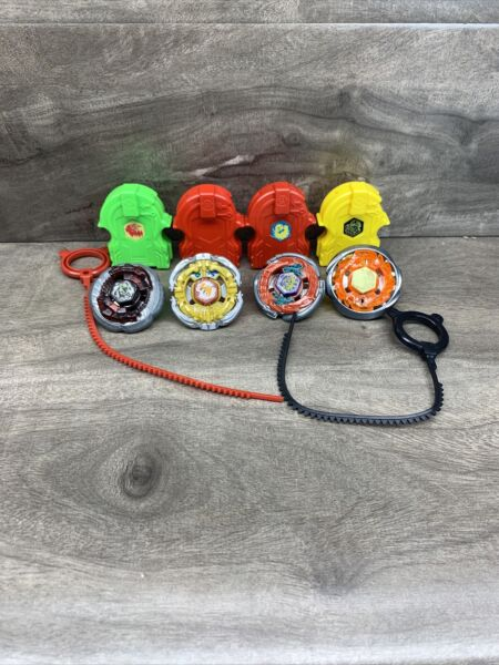 4 Lot of Beyblades Metal and 4 Plastic Launchers And 2 Rip Cords