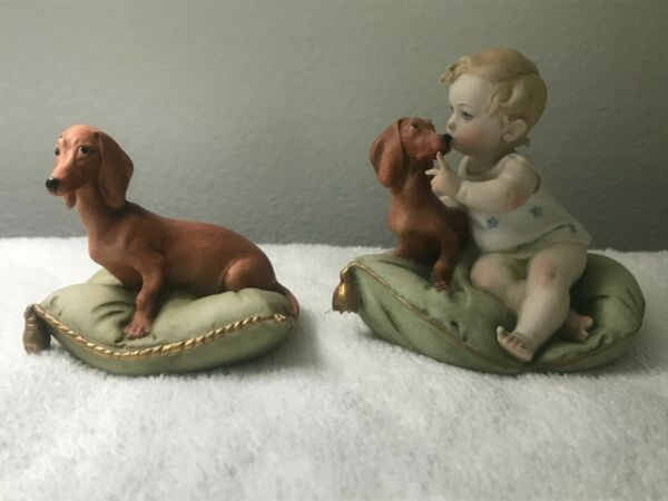Capodimonte figurines #99009 Child w dog on pillow and #99068 Dog on pillow $200.00
