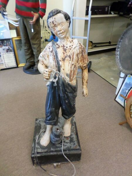 VINTAGEANTIQUE CAST IRON LAWN JOCKEY