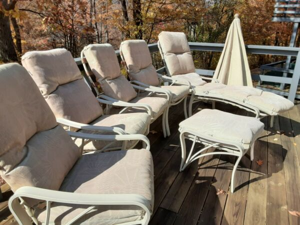 Outdoor Furniture Four Chairs Ottoman Lounger and Umbrella $300.00