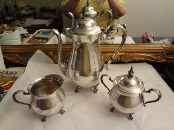 SILVERPLATE COFFEE SET...COFFEE POT CREAMER AND SUGAR BOWL