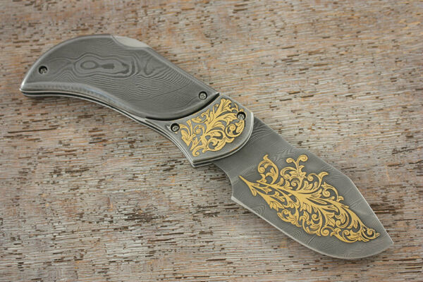 Premium Custom Author's  folding Damascus knife decorated with gold