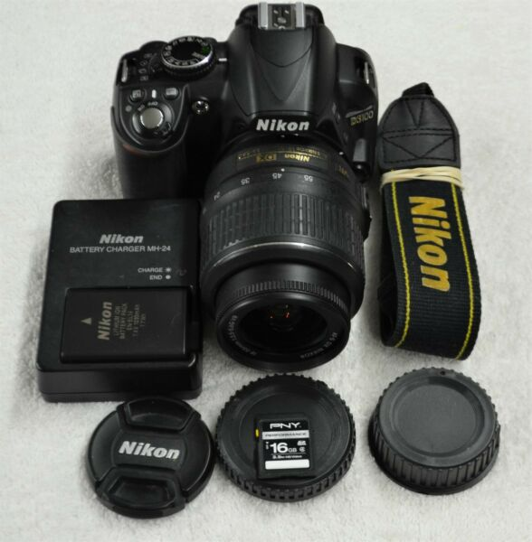 Nikon D D3100 14.2MP Digital SLR Camera with AF S DX VR 18 55mm Lens