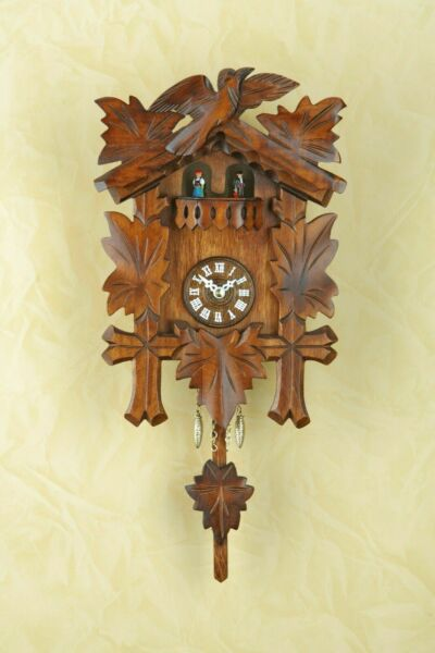 German Black Forest cuckoo clock with Quartz movement rotating dancers in colors
