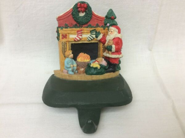 VINTAGE SANTA BY FIREPLACE CAST IRON CHRISTMAS STOCKING HANGER