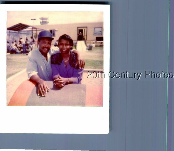 FOUND COLOR POLAROID P7316 BLACK MAN IN HAT POSED WITH PRETTY WOMAN
