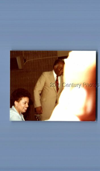 FOUND COLOR PHOTO L 6646 BLACK MAN IN SUIT POSEDPRETTY WOMANOBSTRUCTION