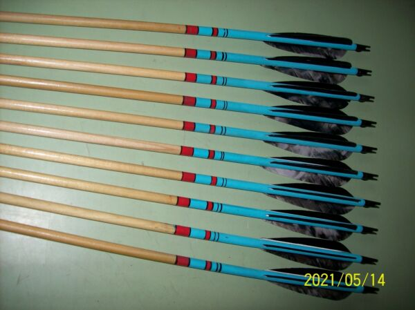 10 Used wood field type arrows with feathers $55.00
