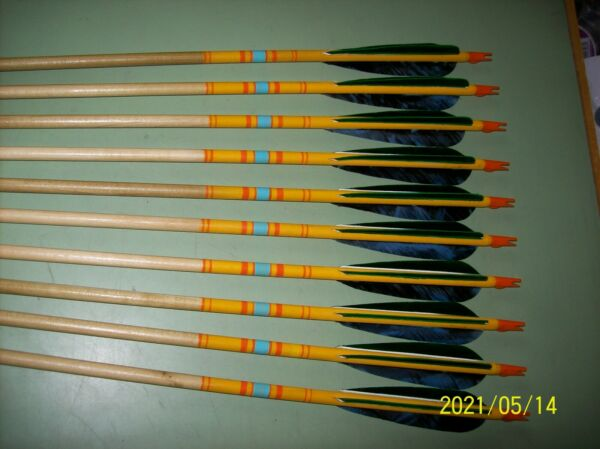 10 Used wood field type arrows with feathers 30 3 4 quot; . $60.00