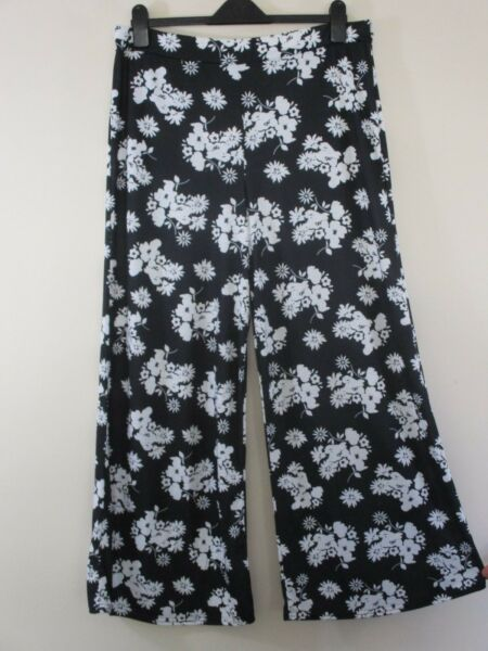 BooHoo wide leg trousers.NWOT UK 18.EU 46 Blk with wht floral print.Holiday.