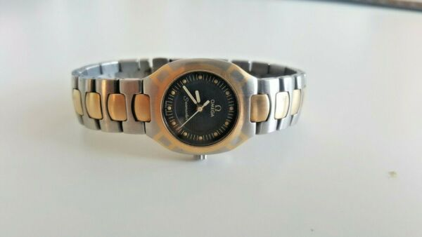 OMEGA POLARIS 18K AND STAINLESS STEEL WATCH.