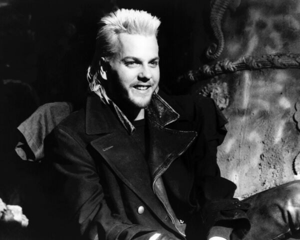 The Lost Boys Kiefer Sutherland smiling seated pose 8x10 Photo