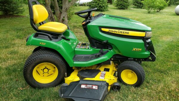 John Deere x534 tractor riding mower           WITH snow  plow attachment