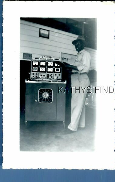 FOUND Bamp;W PHOTO H7079 BLACK MAN IN HAT POSED BY MOTOR TESTER MACHINE