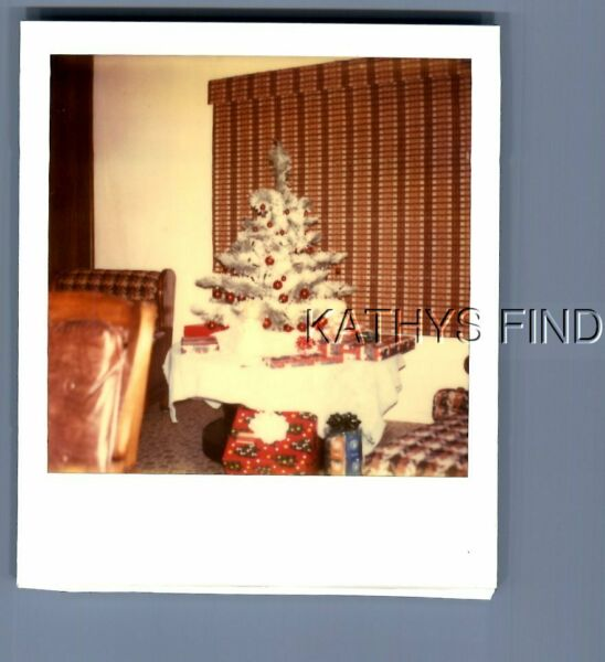 FOUND COLOR POLAROID U 6234 PRESENTS UNDER SMALL CHRISTMAS TREE ON TABLE $3.98