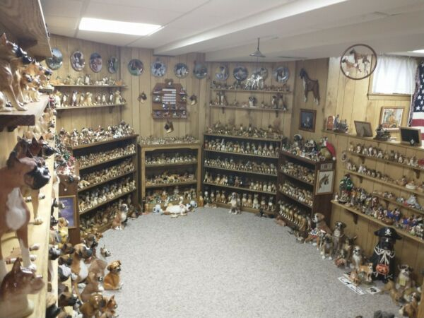 Collection of 1200 Boxer Dog Figurines $18000.00