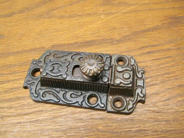 OLD CAST IRON SLIDING CUPBOARD LATCH.....ORNATE DETAIL.....