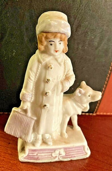 Porcelain Figurine of a Nurse with dog made in Germany $35.99