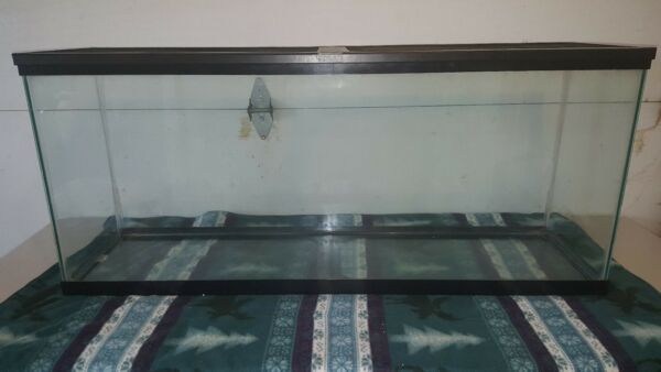 Used 55 gallon fish tank with accessories  $140.00