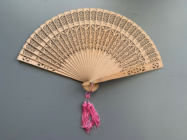 Intricate Carved Wood Fan With Pink Tassle $25.00