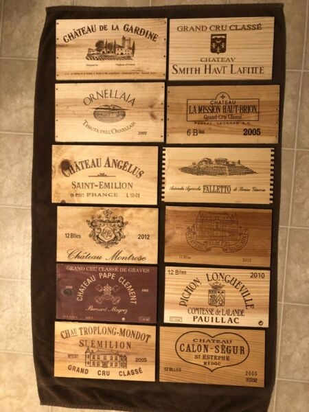 12 Different mostly French wooden wine box end panels