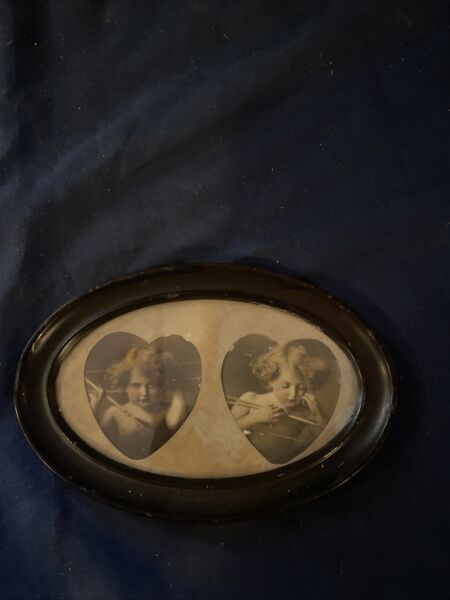 Small Antique Metal Oval Frame With Pictures Of Cherubs