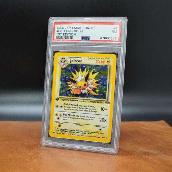 1999 Pokemon Jungle 1st Edition Holo Jolteon 4 64 PSA 7 NM $200.00