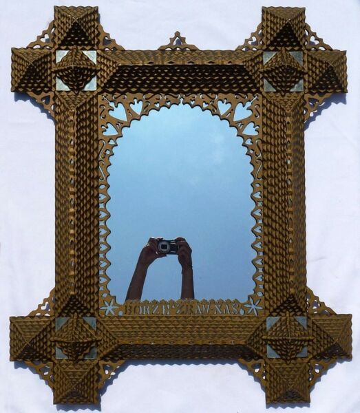 An extremely well made large unusual tramp art frame. GREAT PIECE!